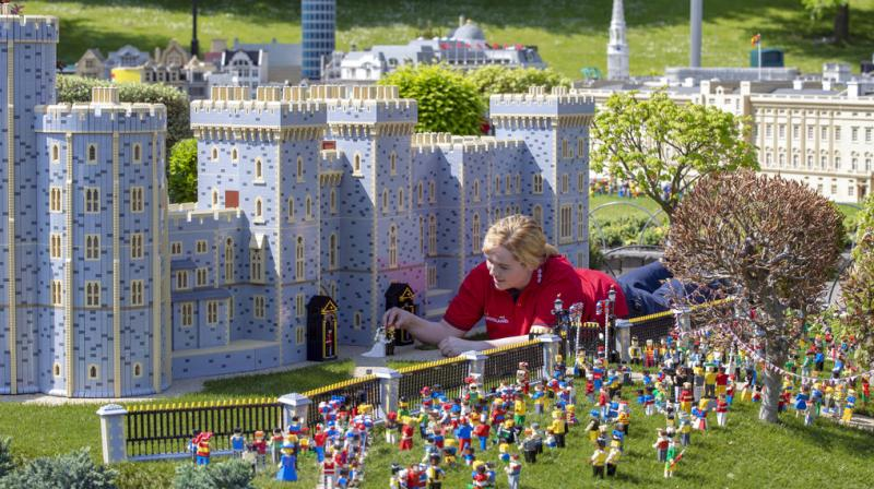 Model maker Lucy Gullon puts the finishing touches to a Lego depiction of the forthcoming wedding of Prince Harry and Meghan Markle, complete with a 39,960 brick version of Windsor Castle, in Legoland Windsor, England. The model took eight model makers 592 hours to build. (Photo: AP)