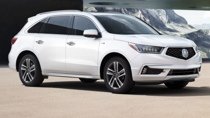 Acura's most popular vehicle, the MDX luxury sport utility, has a more upscale look and more standard safety features for 2017. (Photo courtesy: MotorTrend)