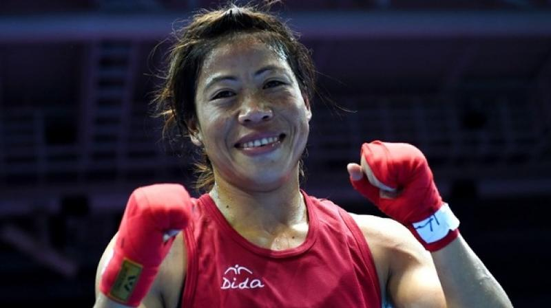 """""""Mary Kom's gold at the Asian Boxing Championship is a huge victory for India's women power. At 34, this mother of 3 has shown that with grit and determination you can overcome seemingly insurmountable odds,"""" said Boxing Federation of India's president Ajay Singh. (Photo: AFP)"""