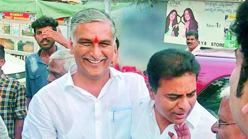 Caretaker ministers and cousins — K.T. Rama Rao (right) and T. Harish Rao (left) — were having ligher moments at Gurragondi village in Siddipet constituency. After casting his vote at Banjara Hills, Mr Rama Rao met his cousin at Gurragondi while he was on his way to his constituency Siricilla.  (R. PAVAN)