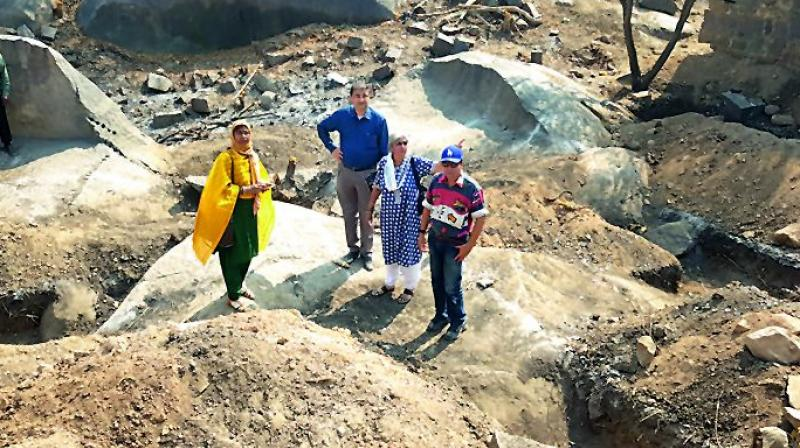 Convenor Intach, Hyderabad Chapter convenor Ms P. Anuradha and others activists inspect the pits.  (Image DC)