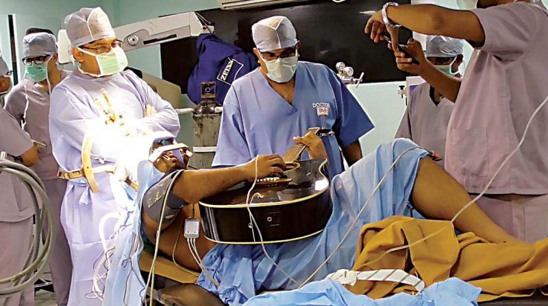 Taskin Ibna Ali playing a guitar during his surgery. (Photo:DC)