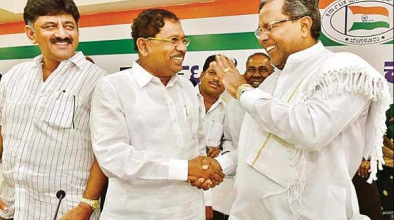 A file photo of Congress leaders Siddaramaiah, G. Parameshwar and Shivakumar