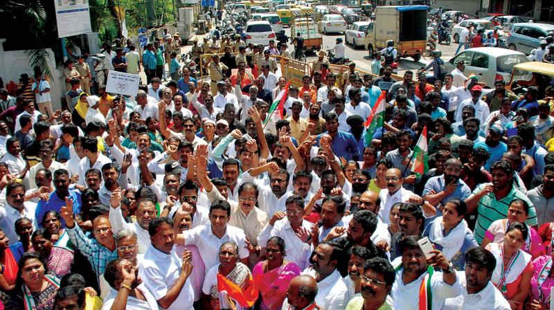Congress workers protest against BJP's 'operation lotus', in Bengaluru on Tuesday. (Photo: KPN)