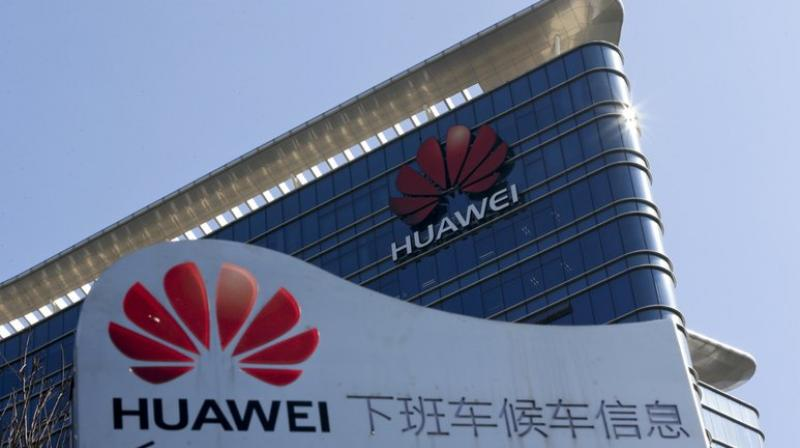 Huawei shipped more than 70,000 5G base stations to markets around the world and signed 40 commercial contracts for 5G with leading global carriers. (Photo: AP)