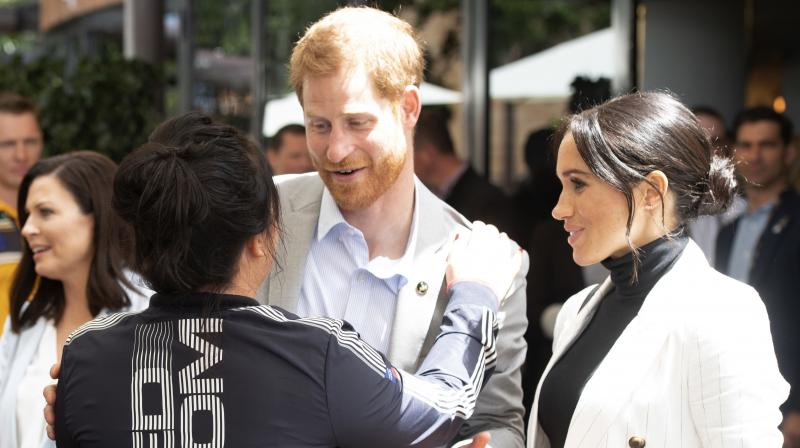 Meghan, Duchess of Sussex, watches her husband Britain's Prince Harry speaks during a lunchtime reception hosted by Australian Prime Minister Scott Morrison with Invictus Games competitors, their families and friends in Sydney Sunday, Oct. 21, 2018. (Photo: AP)