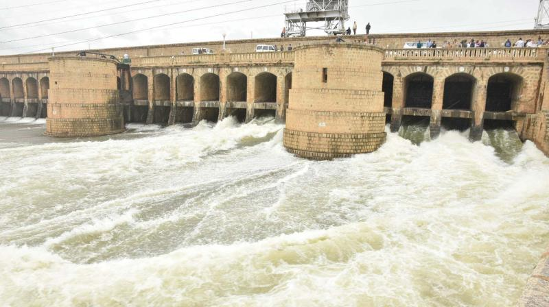 Water being let out of the KRS dam in Mandya district on Saturday.  (KPN)