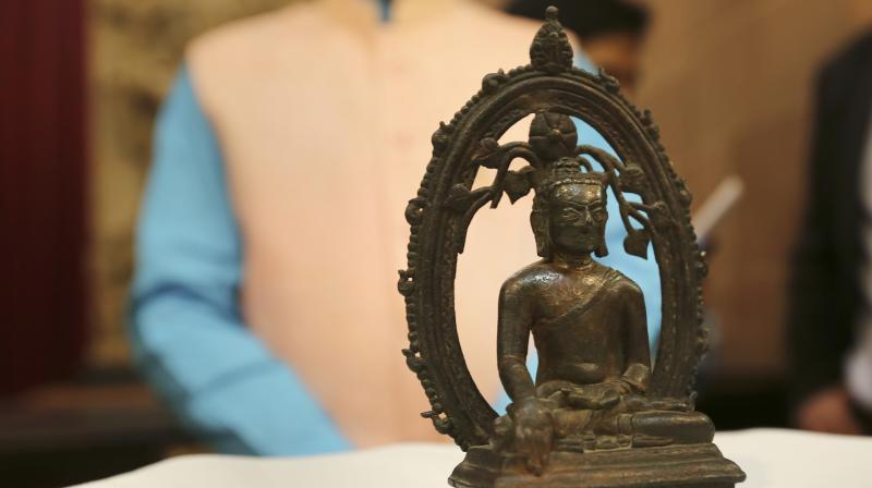 The ancient Buddha statue displayed at the High Commission of India in London Wednesday. (Photo: AP)