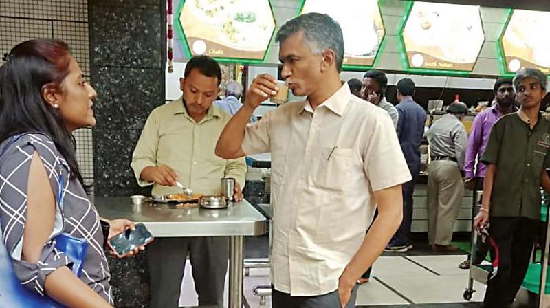 Congress candidate Krishna Byregowda in conversation with a voter at Malleswaram in Bangalore North constituency on Tuesday (Photo: DC)