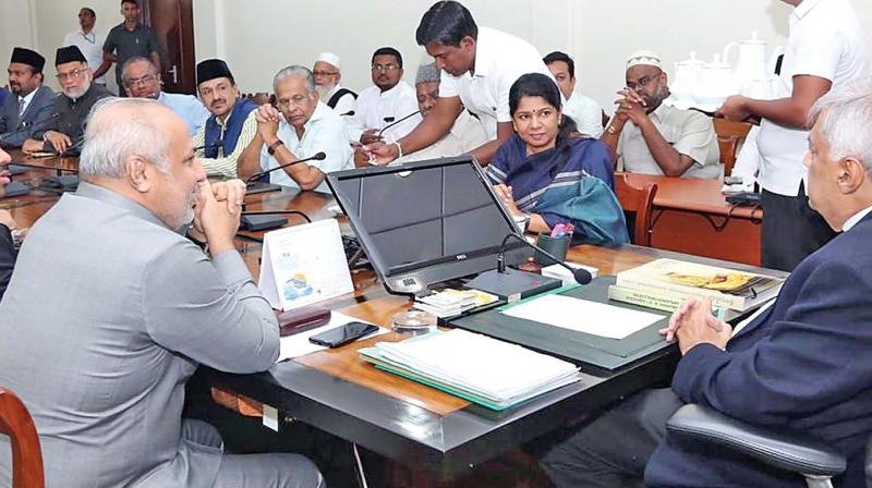 DMK women's wing leader and Thoothukudi MP Kanimozhi on Friday interacts with Sri Lankan Prime Minister Ranil Wickramasinghe in Colombo.