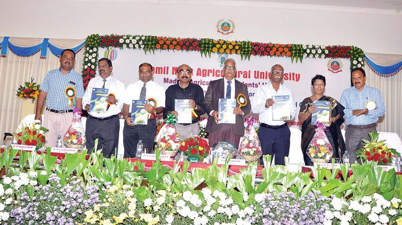 Dr N. Kumar, Vice-Chancellor, TNAU, Coimbatore releases the abstract papers of the conference at Tiruchy on Friday. (Photo: DC)