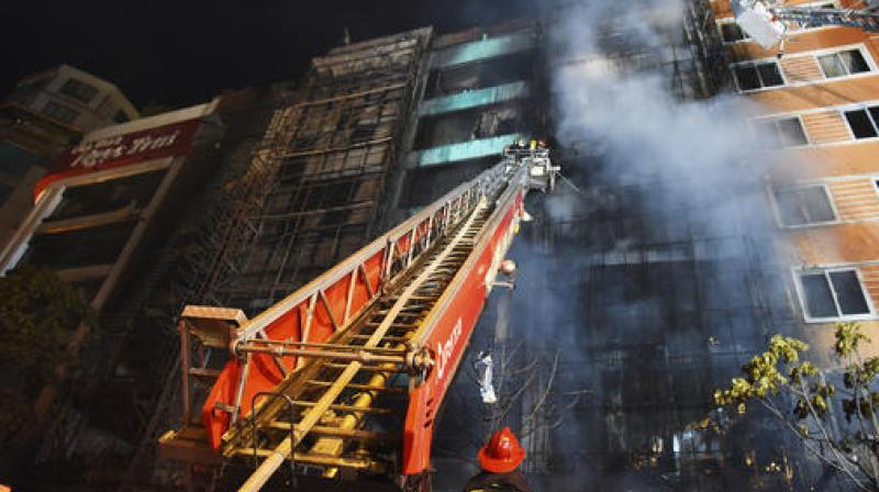 Firefighters extinguish a fire at a karaoke venue in Hanoi, Vietnam. (Photo: AP)