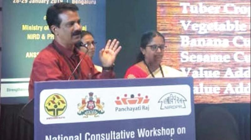 Agriculture Officer V.R. Binesh presents the model at the national level workshop in Bengaluru on Monday.