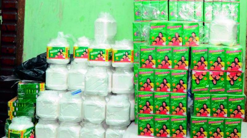 Task Force police raid glucose making companies producing adulterated product at I Town in Vijayawada on Thursday. (Photo: DC)