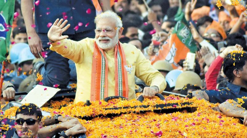 Prime Minister Narendra Modi at a road show in Varanasi during the Uttar Pradesh Assembly election campaign. (Photo: PTI)