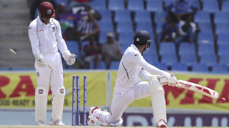 After he was sent back to pavilion with 38 runs score against West Indies on day three of the ongoing first Test, batsman KL Rahul on Sunday said that he was very disappointed adding that he needs to be patient in order to improve his game. (Photo:AP)