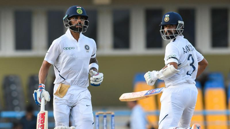 India reached a strong position on Day 3 of the first Test match between India and West Indies, after Indian captain Virat Kohli and vice captain Ajinkya Rahane put on an unbeaten 104 runs partnership to extend India's lead to 260 after losing three early wickets with two more days to be played.  While Kohli and Rahane put on an unbeaten 104 runs stand, the duo scripted history. (Photo:AFP)