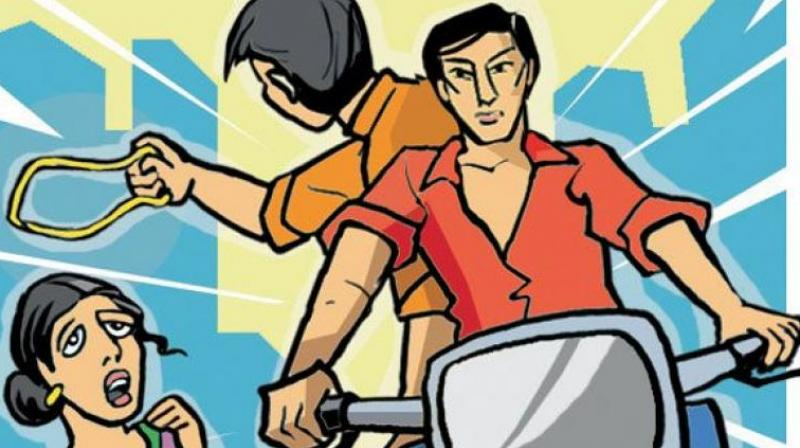 The duo on a two-wheeler, who were trailing the couple, suddenly snatched the 13 sovereign gold chain from Glory.