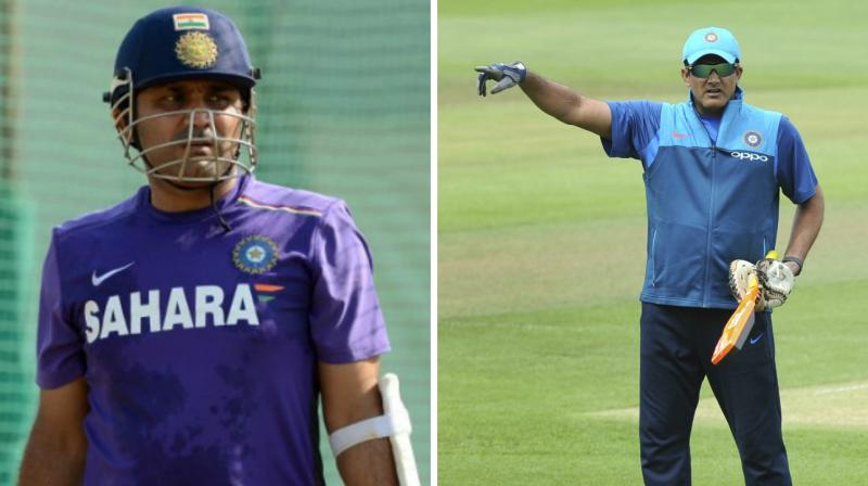 While Virender Sehwag is the frontrunner to replace Anil Kumble as Team India head coach, he said that it will be a difficult to fill into Kumble's boots. (Photo: AFP / AP)
