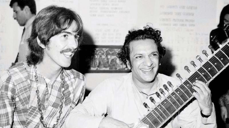 The musician with Pt Ravi Shankar.