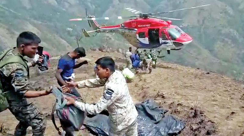 Bodies recovered by the Garud commandos of the IAF were found lying in crevices on steep rocky slopes  at the Kurangani forest in Theni on Monday. (Photo: DC)