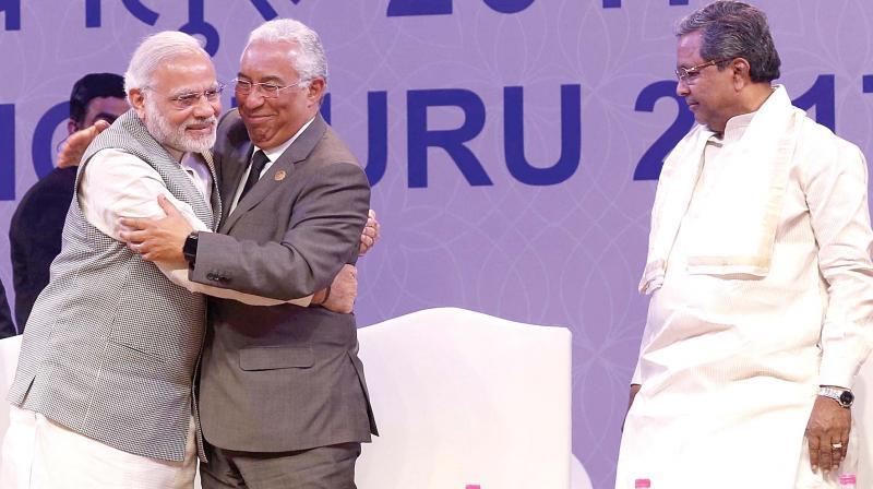 PM Modi greets his Portugal counterpart Dr Antonio Costa as CM Siddaramaiah looks on.