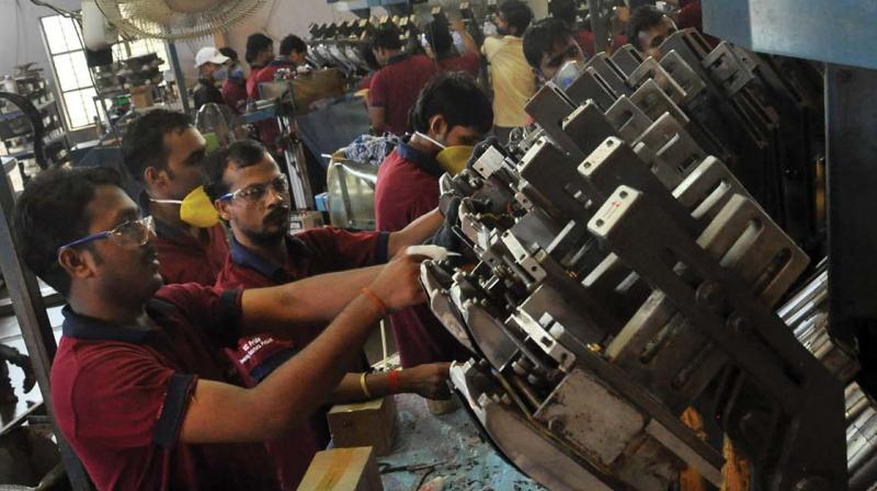 Work in full swing at PU Rotary machine at a footwear unit at Cheruvannur in Kozhikode. (Photo: Venugopal)