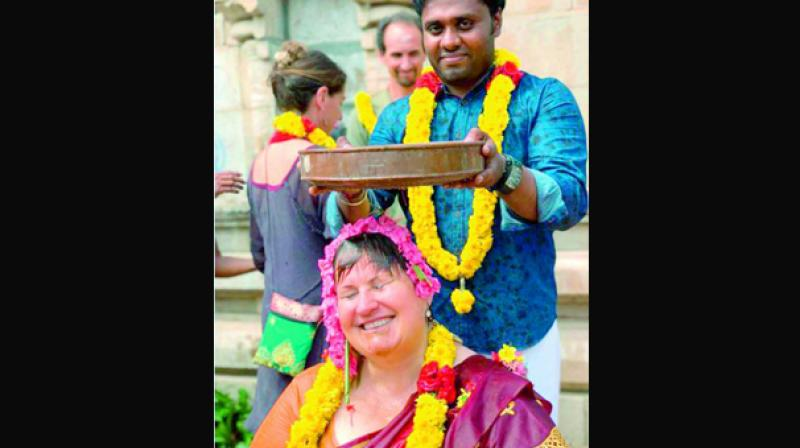 Abishekam performed to Ana alias Annapurani, a tourist from Iceland as part of her mani vizha at Brahmapureeswarar temple at Korkai. (Photo: DC)