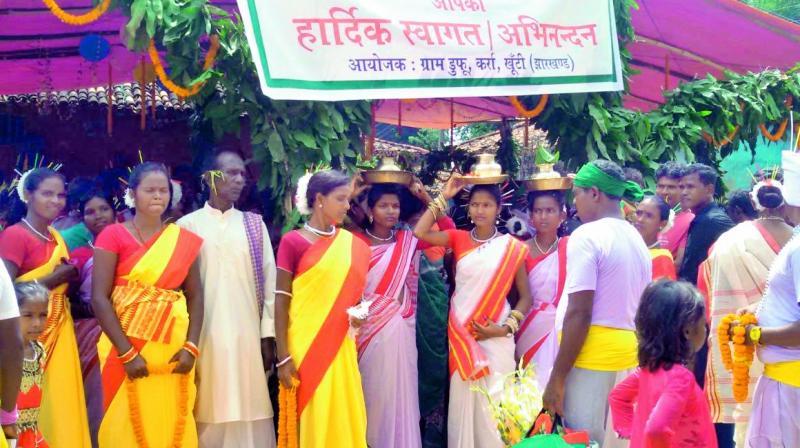 A group of tribal men and women from the Munda community at Karma Mahaustav in Jharkhand —Hercules Munda.