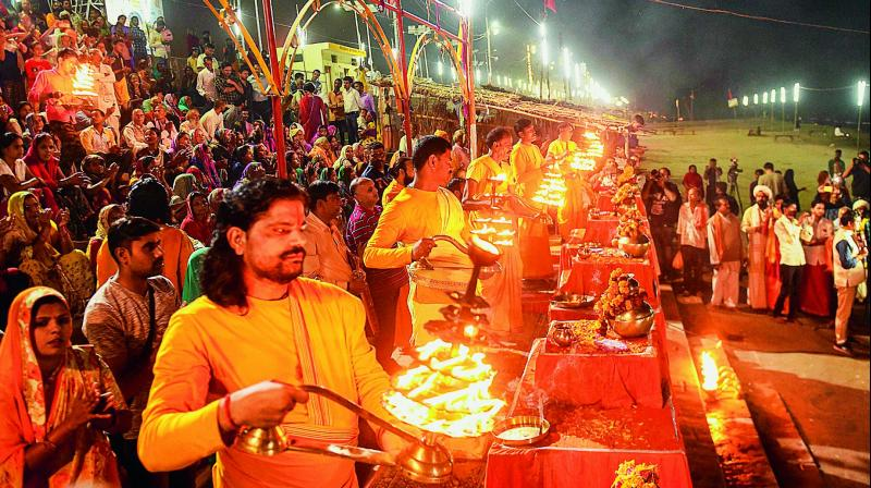 The thanksgiving Devotees offer aarti on the banks of Sarayu after the Supreme Court's verdict in Ayodhya case, in Ayodhya, on Saturday. (Photo: AP)