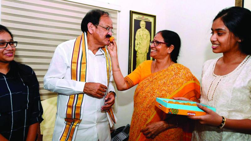 Union Minister M. Venkaiah Naidu is offered sweets by his wife Usha and other family members, after he was announced as the NDA Vice-Presidential candidate in New Delhi on Monday. (Photo: PTI)