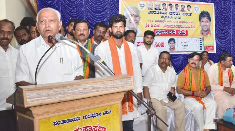 BJP state president B.S. Yeddyurappa addressing a BJP leaders meeting along with Mysuru-Kodagu candidate Pratap Simha in Mysuru(Photo: KPN)