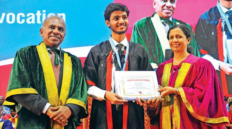 Prof. Subra Suresh VC of NTU, Singapore and  NIT-T's Director Dr Mini Shaji Thomas present a degree to Rupesh Gupta, Department of E&C Engg, during the 15th convocation of the NIT-T, Tiruchy on Saturday. (Photo: DC)