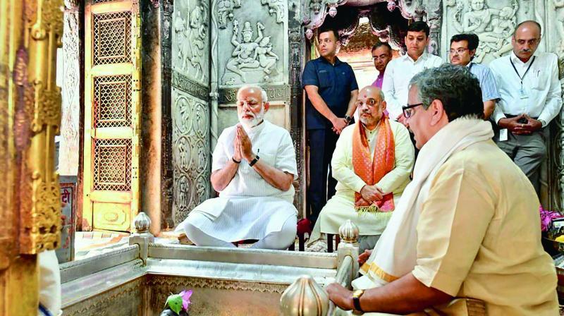 Prime Minister Narendra Modi along with BJP president Amit Shah offers prayers at Kashi Vishwanath Temple in Varanasi on Monday. (Photo: AP)