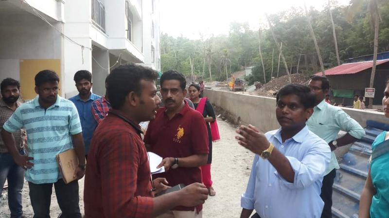 Sub-collector K Inbasekar questions the representatives of the Federal Tower construction site, from where the construction materials where brought to landfill the Akkulam Lake in Thiruvananthapuram on Monday.