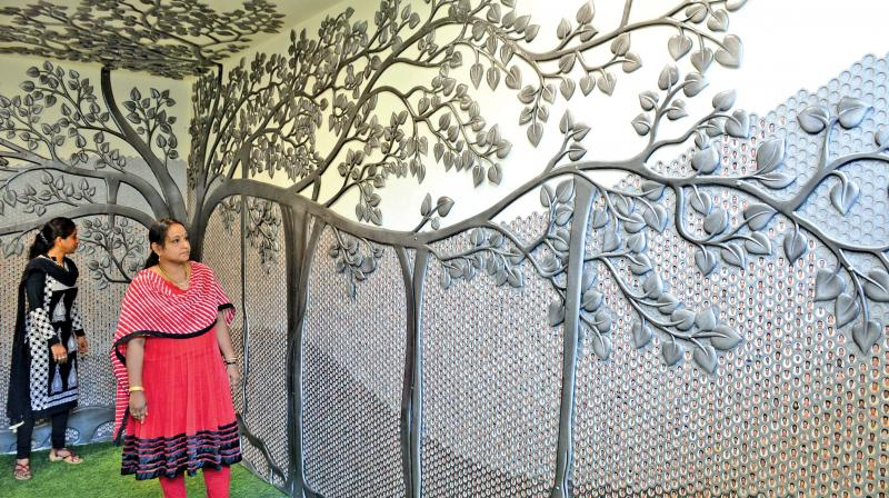 A massive tree featuring photos of all 11,300 employees of the Integral Coach Factory (ICF) has been carved in the administrative building (Photo: DC)