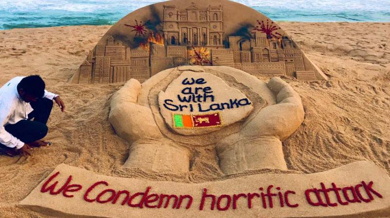 Sand artist Sudarshan expresses through his work on the Puri beach in Odisha his grief for the horrific attacks in Sri Lanka and pledges  solidarity with the traumatised island nation. 	(Courtesy: BBC)