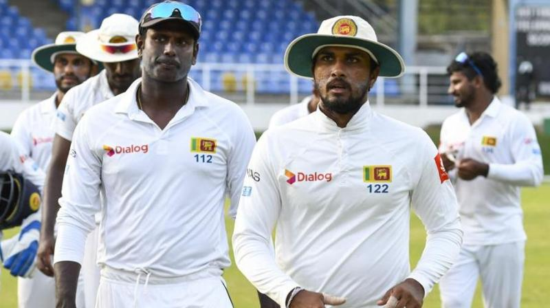 "Gamage fractured a finger batting in the first Test which Sri Lanka lost on Sunday, said a board statement. Mathews withdrew due to a ""personal reason"", it added. (Photo: AFP)"