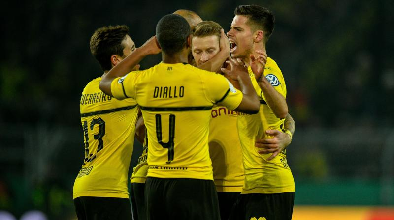 Reus went off after drilling in a superb free-kick, his 17th goal in all competitions this season, in Tuesday's shock German Cup home defeat by Werder Bremen. (Photo: AFP)