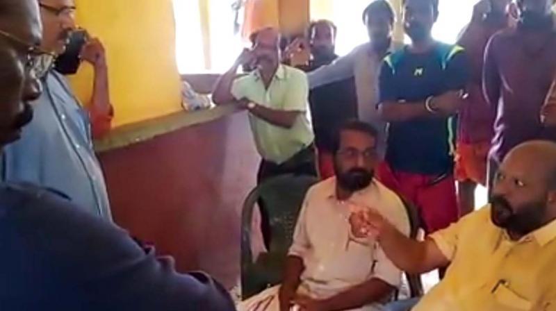 Agriculture minister V.S. Sunil Kumar reprimands engineers of the irrigation dept for not dismantling a temporary bund at Enamavu regulator in Thrissur