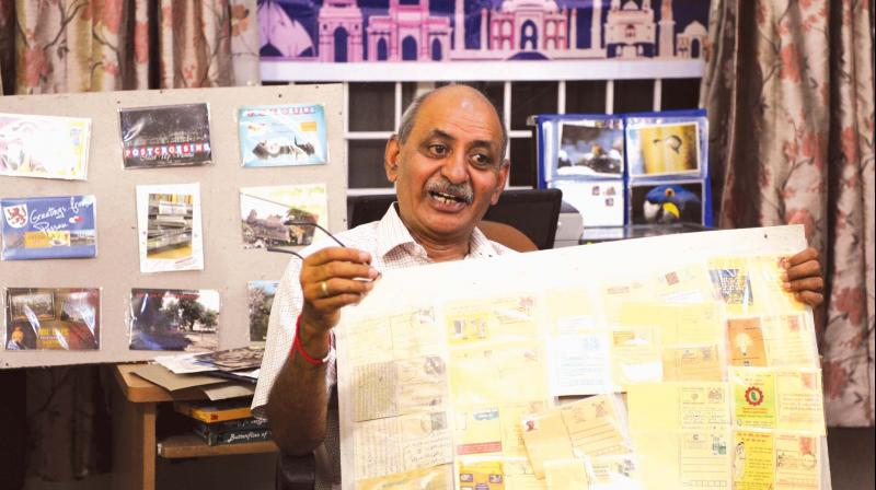 Colonel Akhil Kumar (retd) with his postcards (Photo: R. Samuel)