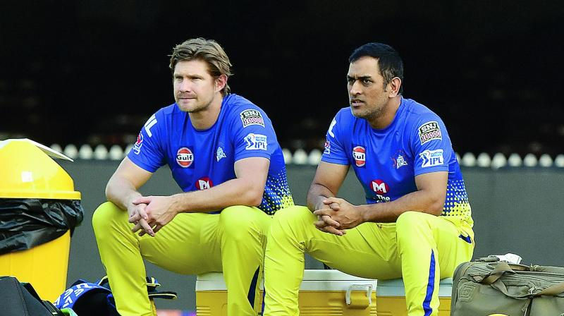 Shane Watson (left) and M.S. Dhoni during a training session in Chennai on Monday. (Photo: DC)