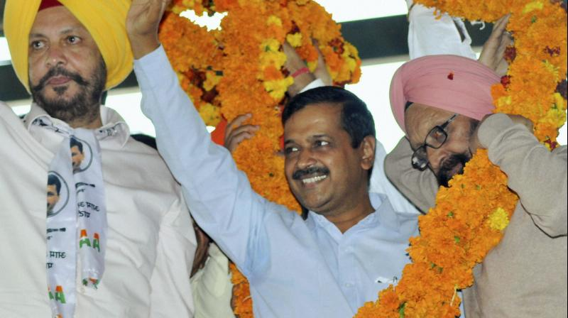 National Convener of Aam Aadmi Party (AAP) and Delhi Chief Minister, Arvind Kejriwal is garlanded during a rally in Samana, Patiala. (Photo: PTI)