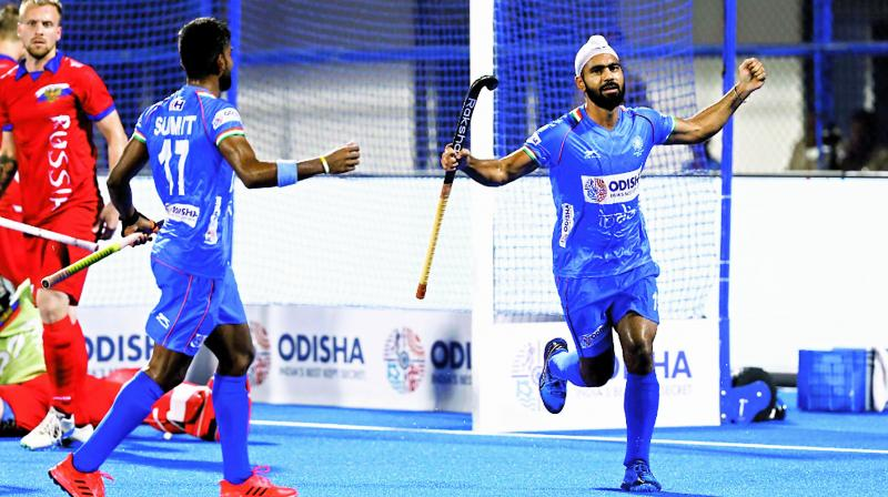 Hockey India tweeted this photo of Simranjeet Singh (right) celebrating after scoring for India against Russia in the men's FIH Series Finals in Bhubaneswar on Thursday.