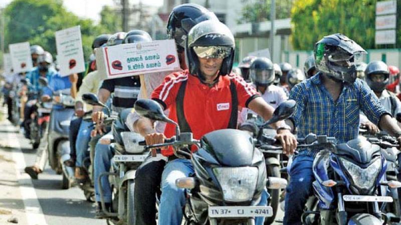 Image of Coimbatore students creating helmet  awareness has been used for representation purpose.