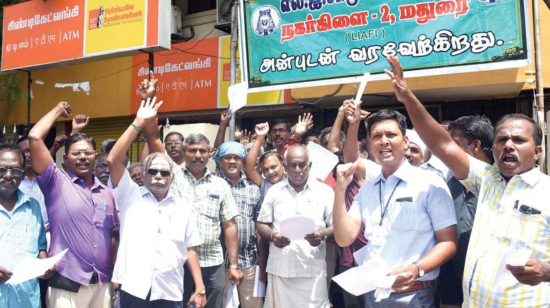 LIC agents protest against GST in Madurai on Saturday	—PTI