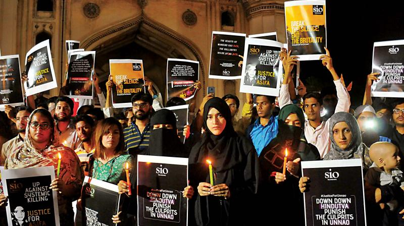 Students of Islamic Organizations (SIO) hold placards during a candle light vigil to protest the Kathua and Unnao rape cases in Hyderabad on Saturday (Photo: File/AP