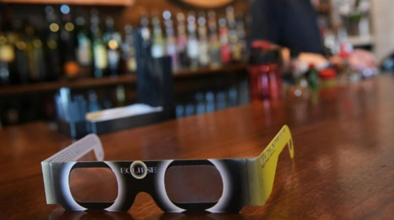 A pair of solar eclipse glasses are seen for sale at a restaurant ahead of the total solar eclipse in Charleston, South Carolina, on August 20, 2017. (Photo: AFP)