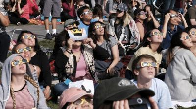 As the Sun took it place behind the moon, and let the latter cast its shadow over earth sky-gazers stood transfixed in North America armed with their protective glasses to glimpse the rare solar eclipse that swept the continent for the first time in nearly a century. (Photo: AFP)