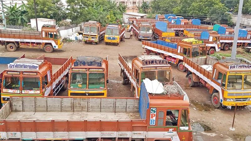 Trucks parked hapazardly at a parking bay in Salem as lorry owners went on a day strike. (Photo: DC)